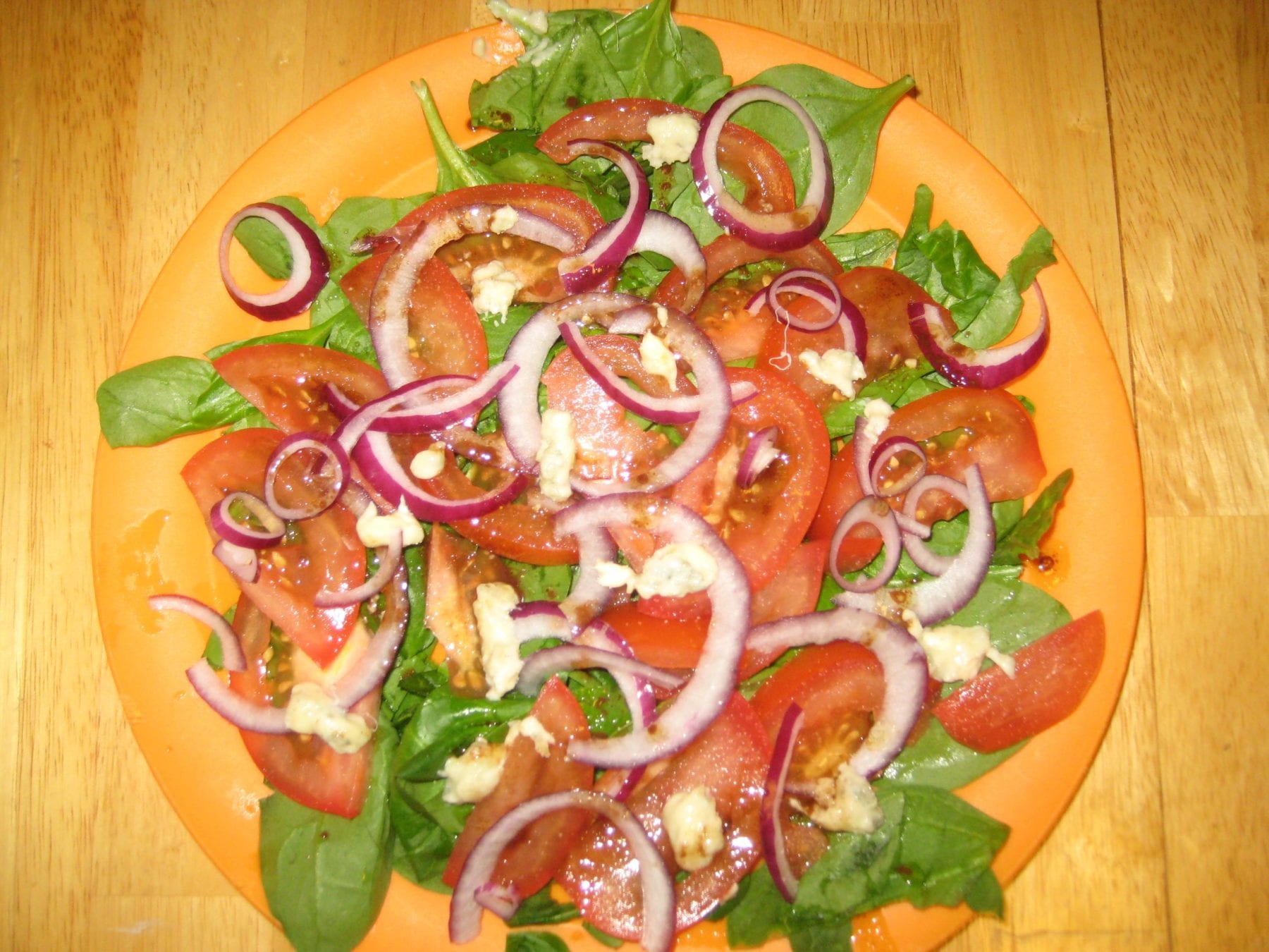 spinach red onion, tomato and walnut salad served with a oil balsamic ...