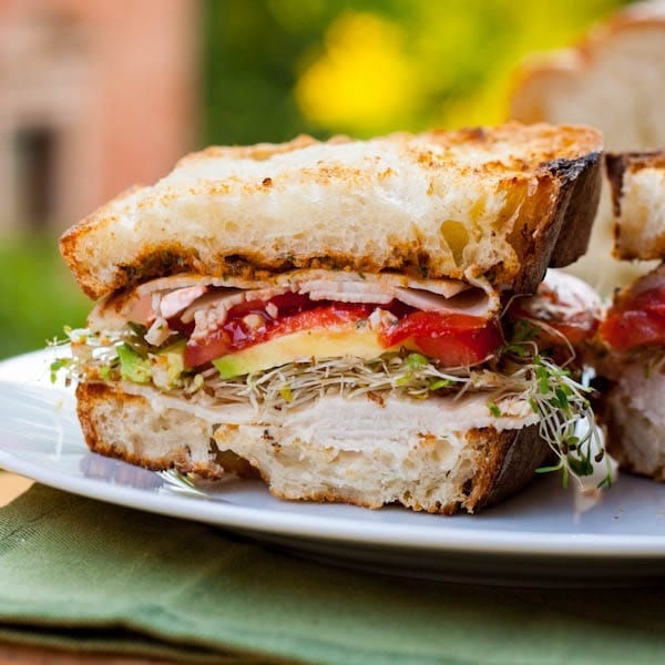 turkey sandwich with avocados and pesto
