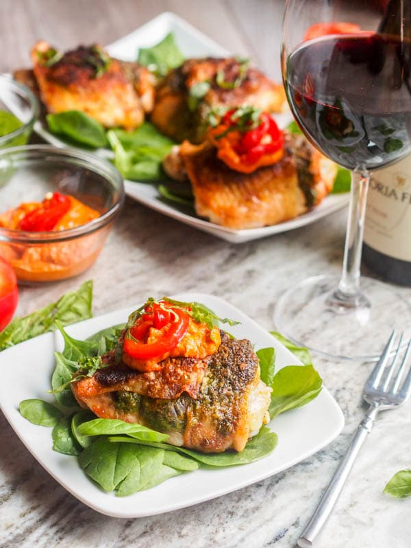 Holiday Broiled Chicken with Pesto and Romesco Sauce make for the perfect 30 minute holiday entertaining meal. Spread the pesto under the chicken skin and broil for 20 minutes, then top with romesco sauce and dinner is ready. Both gluten free and dairy free too.