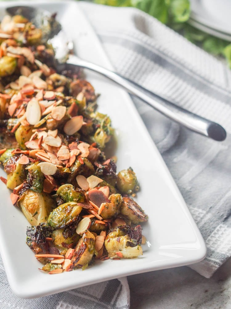 Vegan Pesto Roasted Brussels Sprouts - super simple and made with only a couple ingredient. A perfect side dish. Gluten Free too.