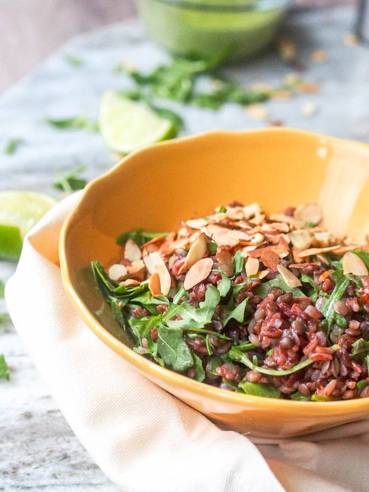 A 9 ingredient healthy vegan winter salad with rice, a lentil trio, arugula, and almonds. All coated in a rich and velvety creamy cilantro tahini dressing. Ready in 45 minutes. Make a big batch and eat for days. Gluten Free too.