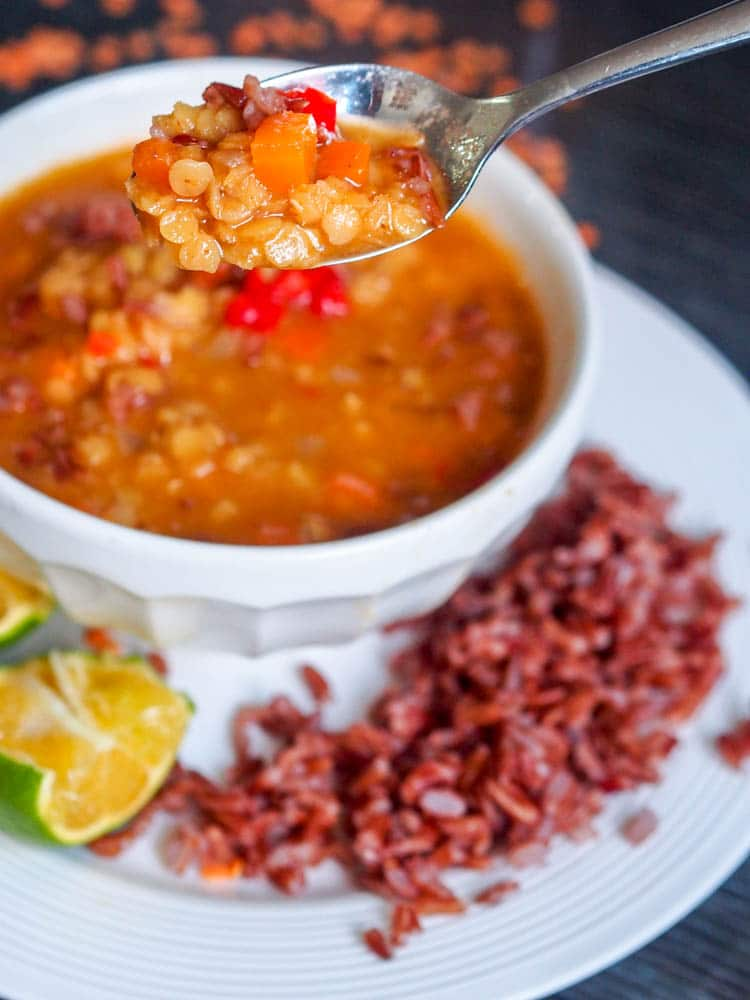 Vegan and Gluten-Free Thai inspired 30 minute lentil and rice soup made with red lentils, red rice and massaman curry paste. Soup and dinner in one.  | avocadopesto.com