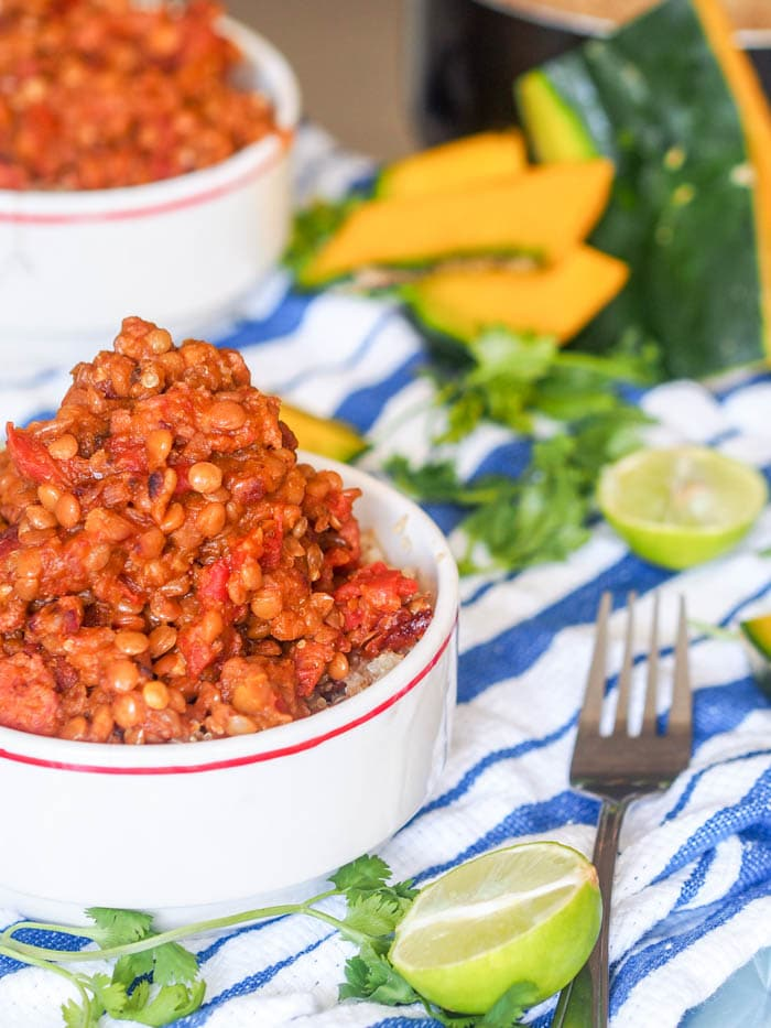 Healthy comfort food at its finest. This dry lentil stew with sausage and squash is perfect served over quinoa and makes for a high fiber and protein rich one pot dinner meal. Gluten Free and Dairy Free. | avocadopesto.com