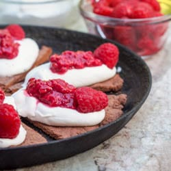 Meet your new favorite dessert - a healthy high protein vegan dessert pizza topped with whipped coconut cream and raspberry sauce | avocadopesto.com