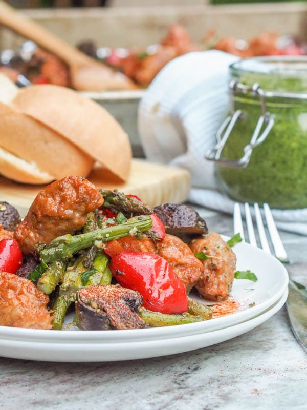 5 ingredients - pesto, chicken sausage, asparagus, red peppers and mushrooms is all you need for this simple and healthy chicken sheet pan dinner recipe that makes for the ultimate low fuss weeknight dinner. Gluten Free + Dairy Free too. | avocadopesto.com