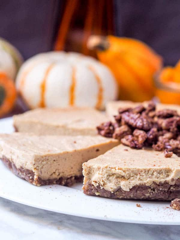 A classic fall dessert made healthier and vegan - maple pumpkin cheesecake with almond butter and coconut milk topped with candied pecans and whipped coconut cream. GF too. | avocadopesto.com