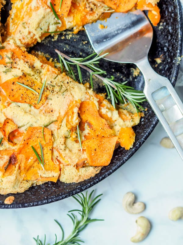 Super creamy and comforting vegan + paleo butternut squash gratin with rosemary cashew cream is the perfect meatless entree or side dish for a fall themed dinner party. Gluten Free. | avocadopesto.com