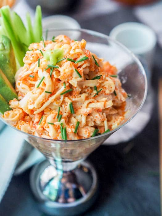 Seafood salad takes on an Asian flair and is made with crab, shrimp, tobiko and mayo with some added spice as well. Gluten-Free and Dairy-Free. A perfect appetizer to an Japanese or Asian themed meal.