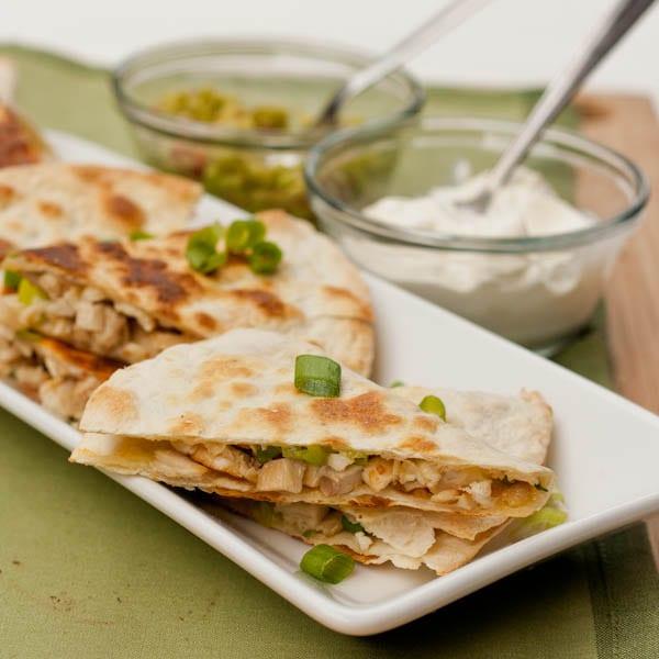 Chicken Quesadillas  with sour cream and guacamole