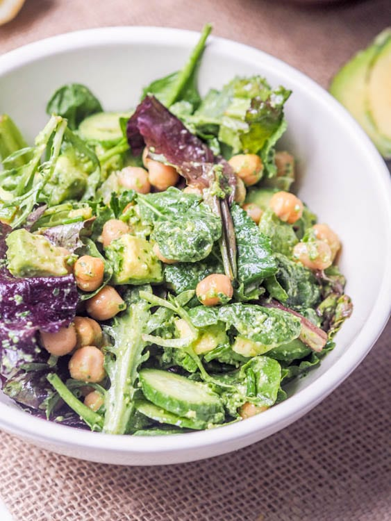 Avocado Chickpea Salad with vegan pesto makes for the perfect lunch recipe that is ready in minutes. Super simple 5 ingredient recipe packed full of flavor and protein. Lunch or grill day appetizers don't get easier than this!