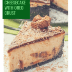 a slice of peanut butter cheesecake with peanut butter cup topping and the remainder of the cake in the background