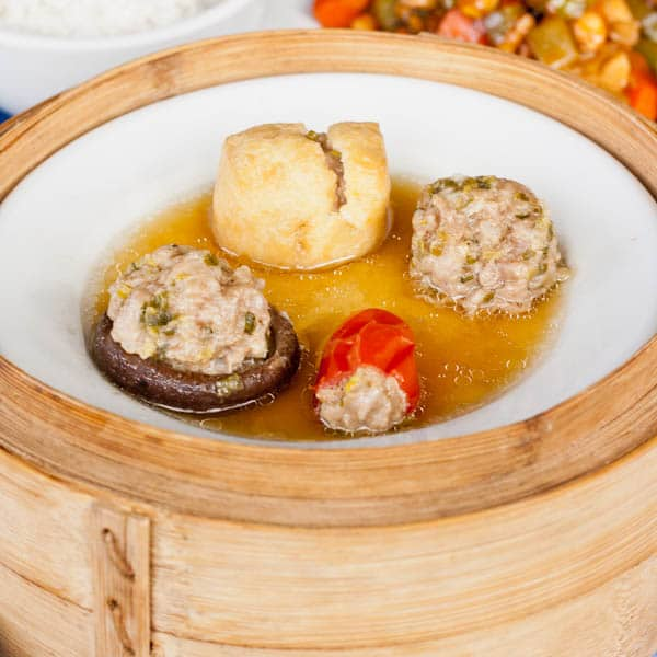 pork stuffed mushrooms in a steaming basket