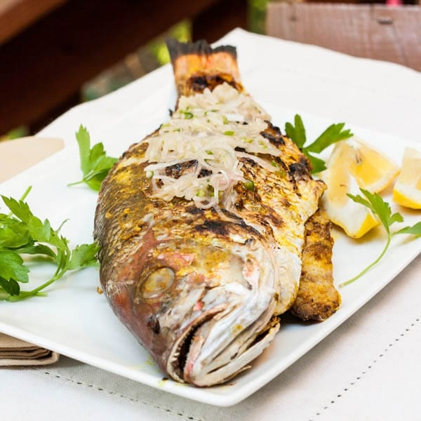 Whole Red Snapper Recipe topped with chili garlic sauce