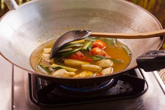 Making the Tom Yum Shrimp Soup in a large wok