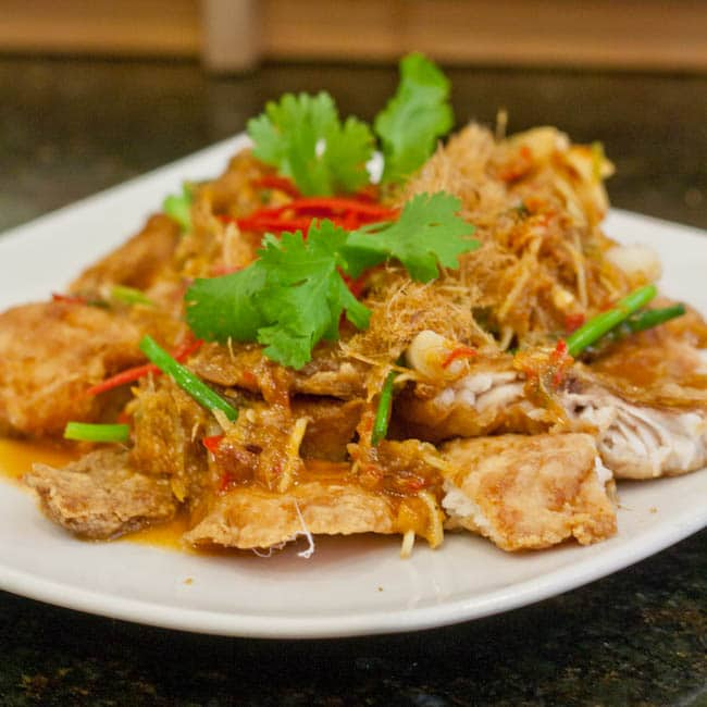 Thai fried fish topped with a lemongrass sauce and fresh cilantro