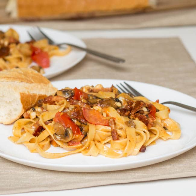 bacon mushroom tomato pasta served with crusty bread