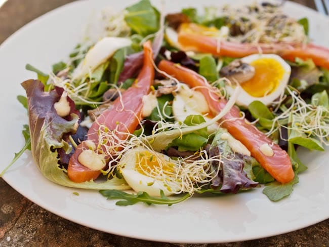 smoked salmon egg salad over greens