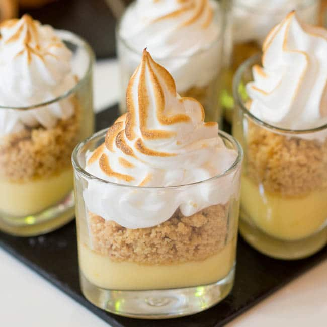 Deconstructed Lemon Meringue Pie with a lemon curd layer, a crumbled and a torched meringue on top