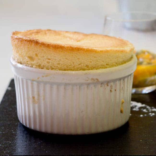 Passionfruit and Banana Souffle lightly lifted up in a ramekin