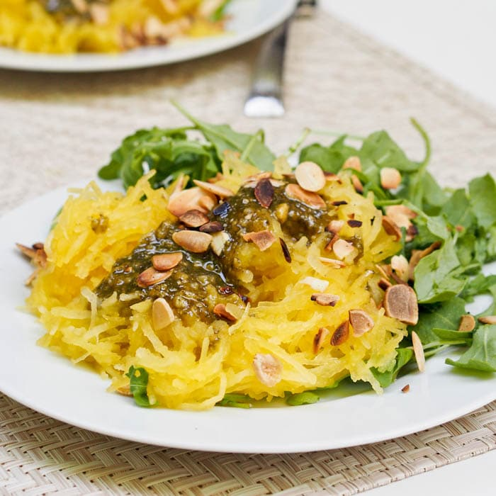 Pesto Spaghetti Squash with Arugula topped with sliced almonds