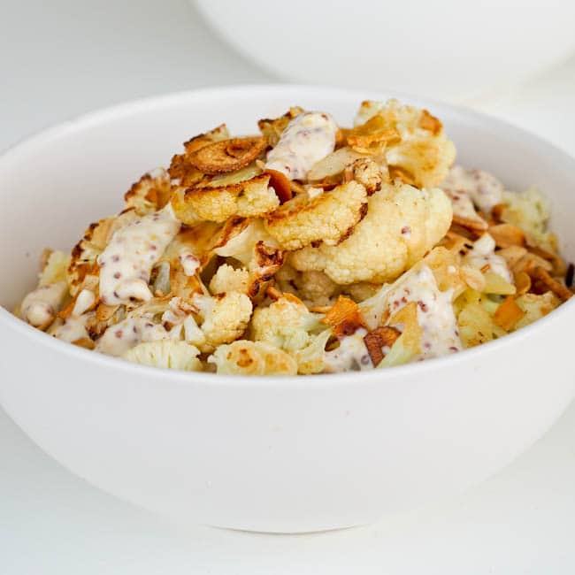 cauliflower couscous salad with creamy dressing and garlic chips