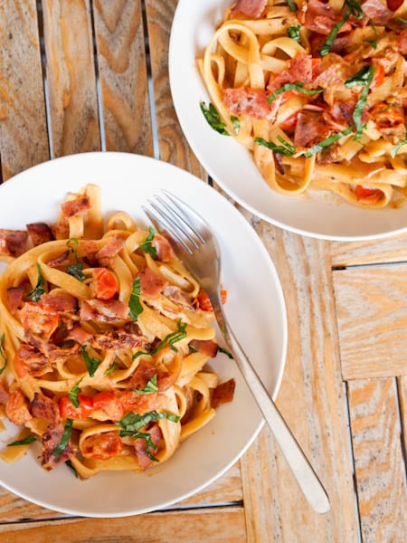 Two Bowls Of Ham And Tomato Pasta Ready To Eat