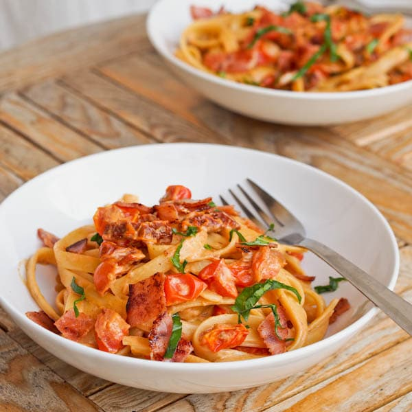 Savory Ham and Tomato Pasta garnished with fresh basil