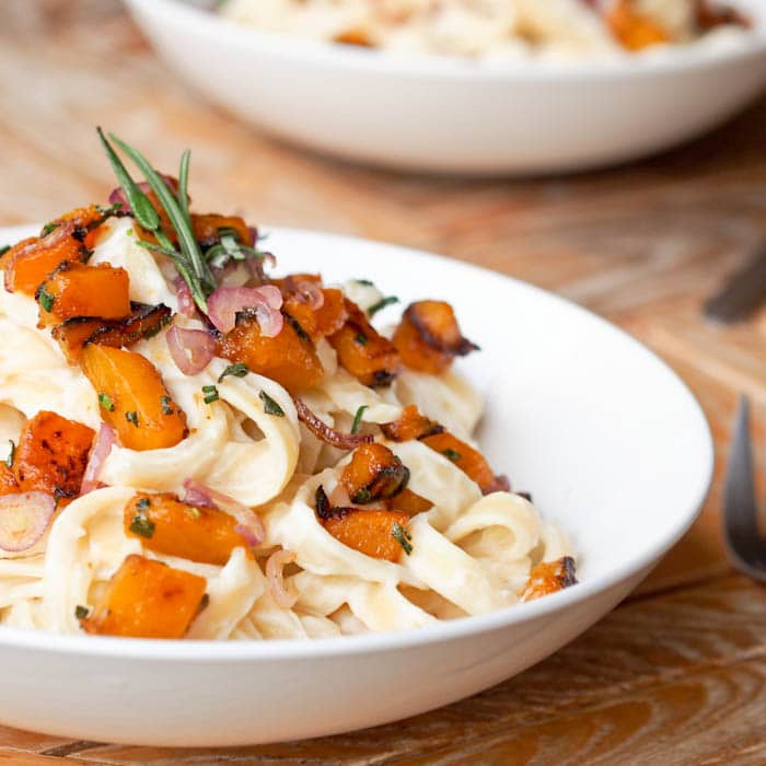 vegan fettuccine alfredo with roasted pumpkin and shallots