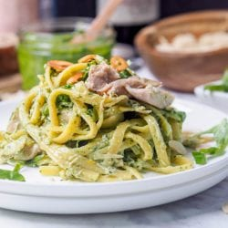 Pesto chicken pasta makes for the perfect quick 30 minute weeknight dinner. Dairy Free recipe with a creamy coconut milk based sauce plus extra flavors of toasted almonds, fried garlic chips and fresh herbs. Gluten-Free too.