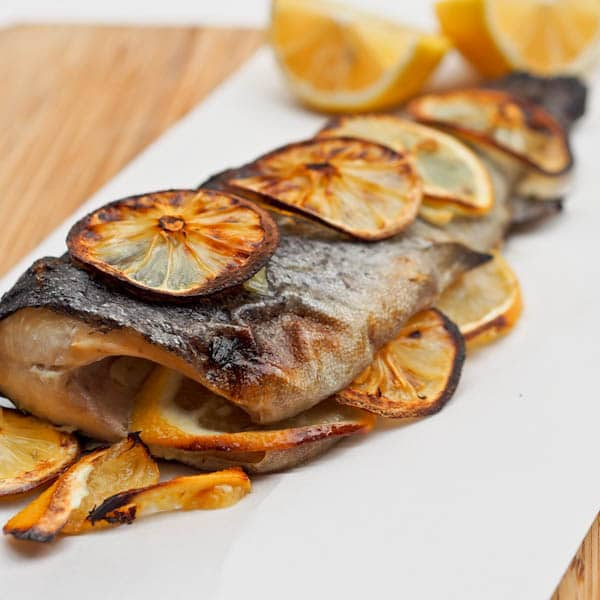 Whole oven Baked Trout topped with Lemon Slices