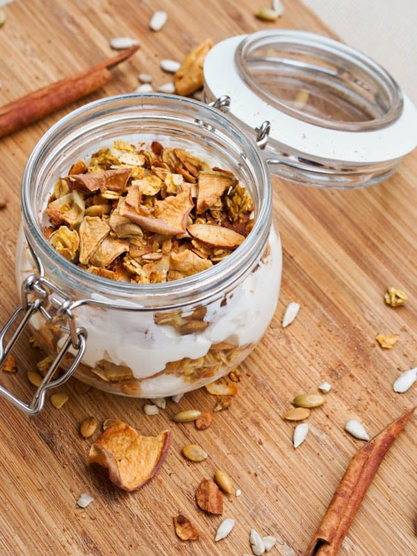 Pumpkin Granola sprinkled over vegan yogurt in a mason jar