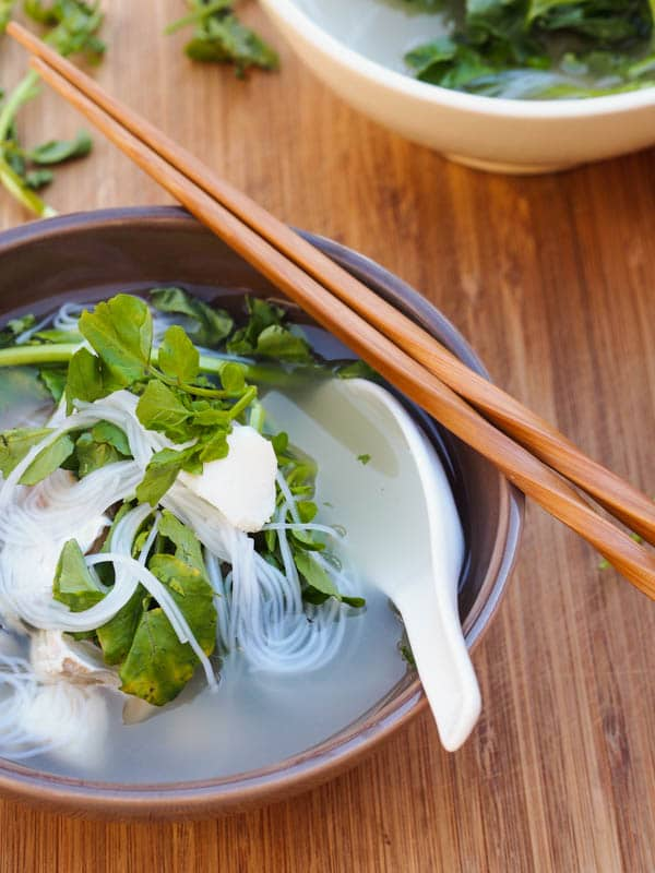 Halibut soup with rice noodles and watercress