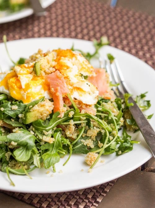 savory breakfast quinoa salad with smoked salmon, arugula and fried eggs