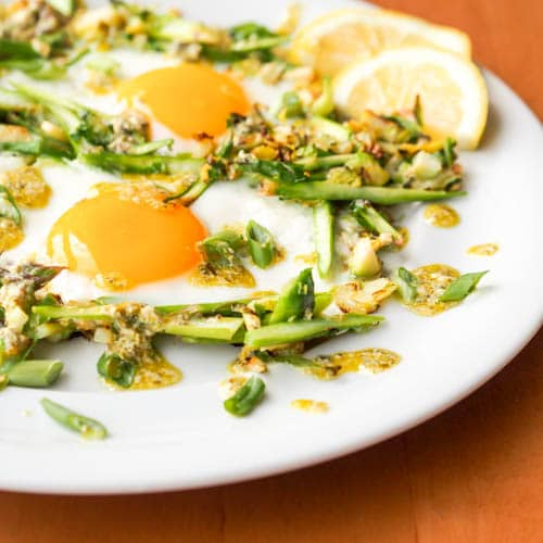 Eggs and asparagus on brussels sprouts hash