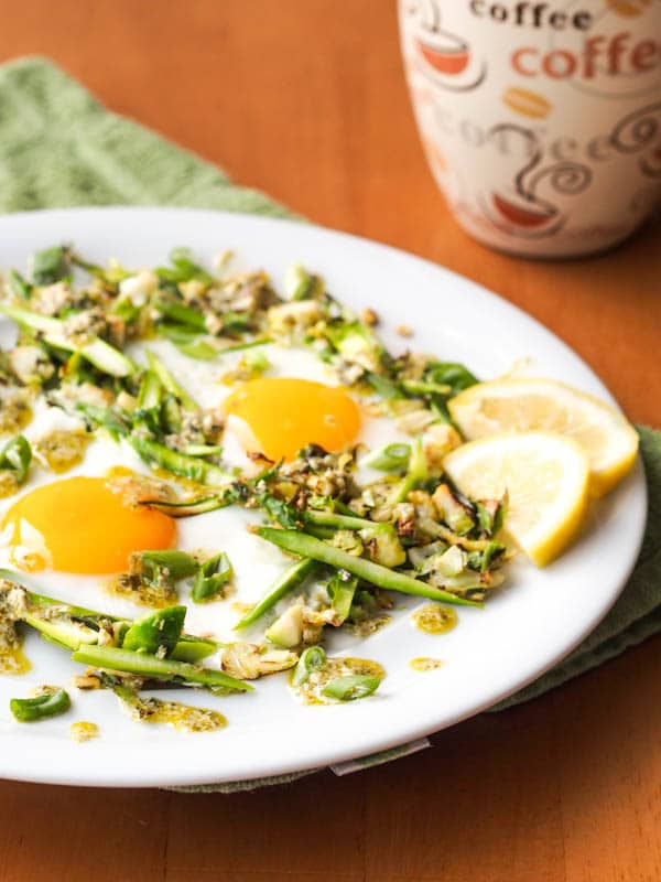 Sunny side up eggs and asparagus on brussels sprouts hash