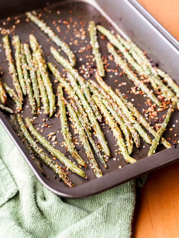 Baked green bean fries in the baking pan