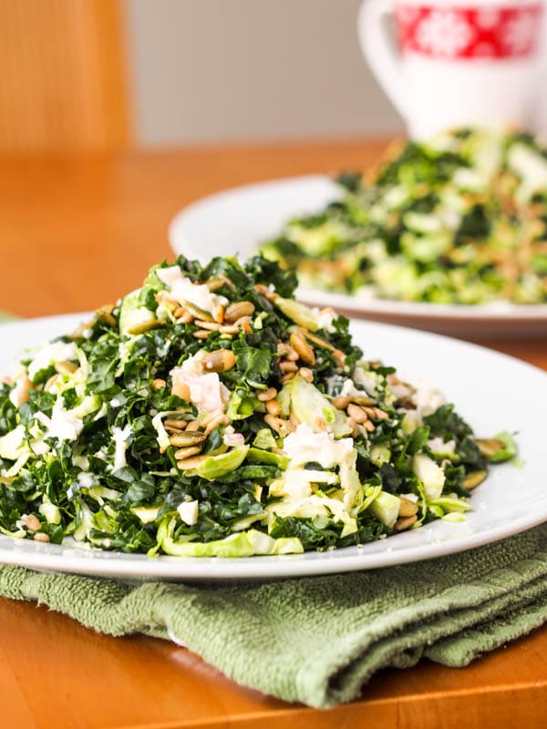 Brussel sprouts kale salad with sunflower seeds and vegan dressing