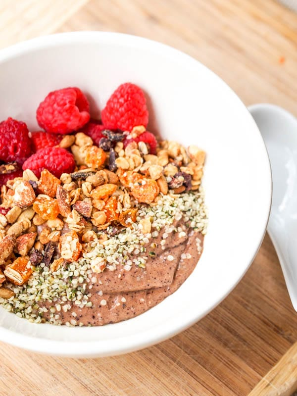 Frozen acai bowl with granola and raspberries