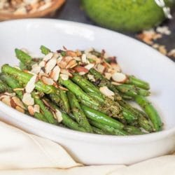 pesto coated green beans sprinkled with almonds
