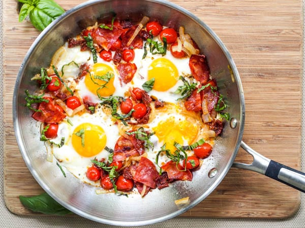 Chorizo Breakfast Skillet with egg, cherry tomatoes and slivered fresh basil