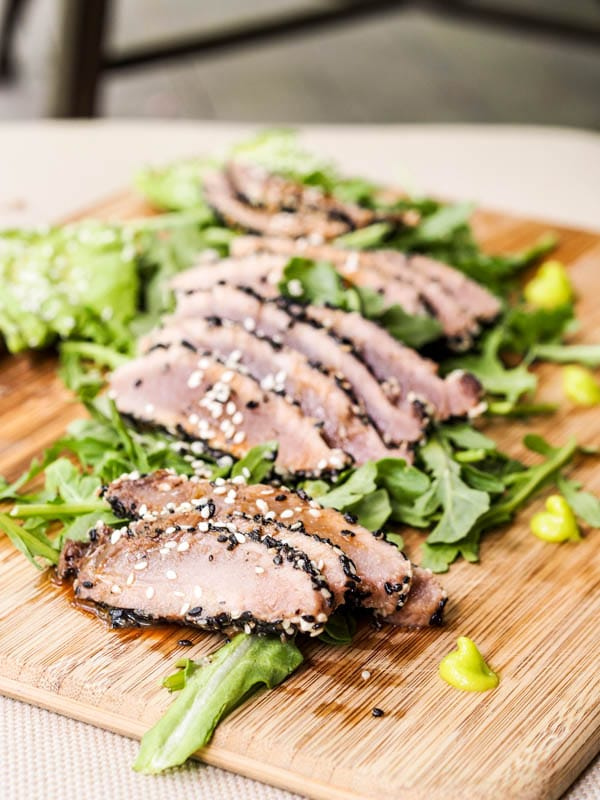Sesame Crusted Ahi Tuna served over arugula