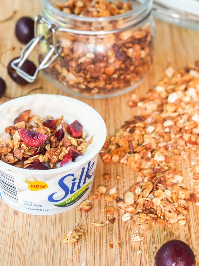 Silk Dairy Free Yogurt Alternative topped with coconut almond granola and chopped cherries
