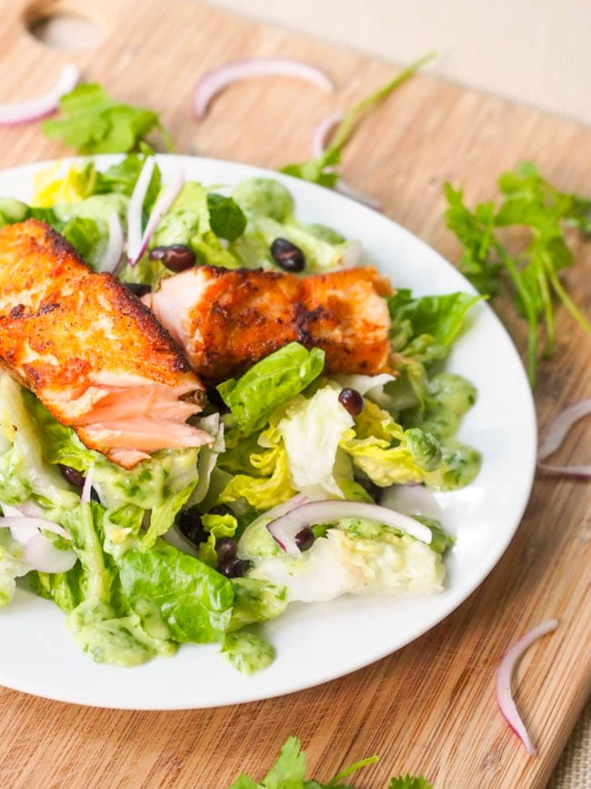Seared Salmon Salad with Avocado Cilantro Dressing, black beans and red onions