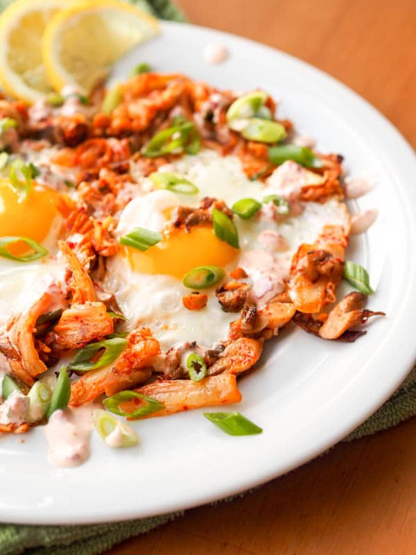 Korean breakfast Kimchi Egg Skillet sprinkled with green onions