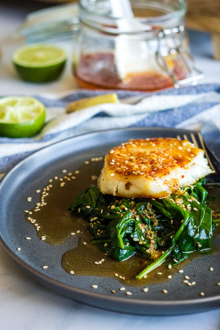 Seared Chilean sea bass over spinach with sauce
