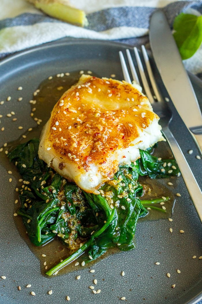 Seared Chilean sea bass over wilted spinach