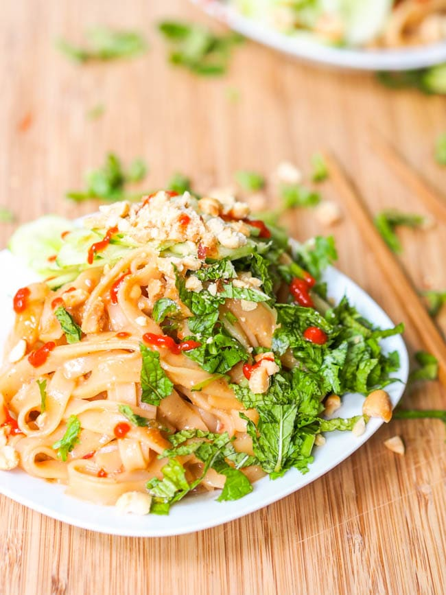Sesame Noodles Salad garnished with fresh herbs and crushed nuts