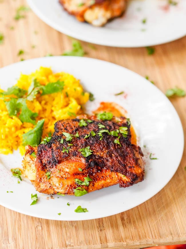 Crispy Garlic Paprika Honey Chicken thighs served with a side of saffron rice