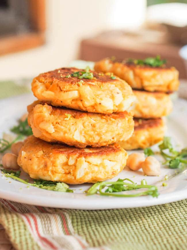 Canned salmon cakes with hearts of palm and chickpeas served with chopped cilantro