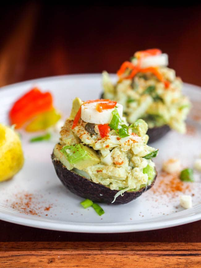 Stuffed avocado with quinoa hearts of palm salad